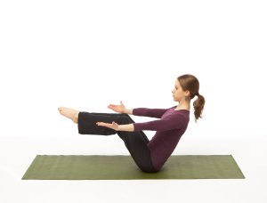 Lift at the heart, drawing arms to either side of the legs. Keep head in a  neutral position.