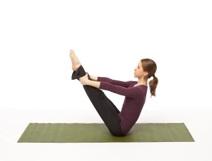 Return to a seated position, draw knees into chest and grasp ankles gently as you straighten the legs.